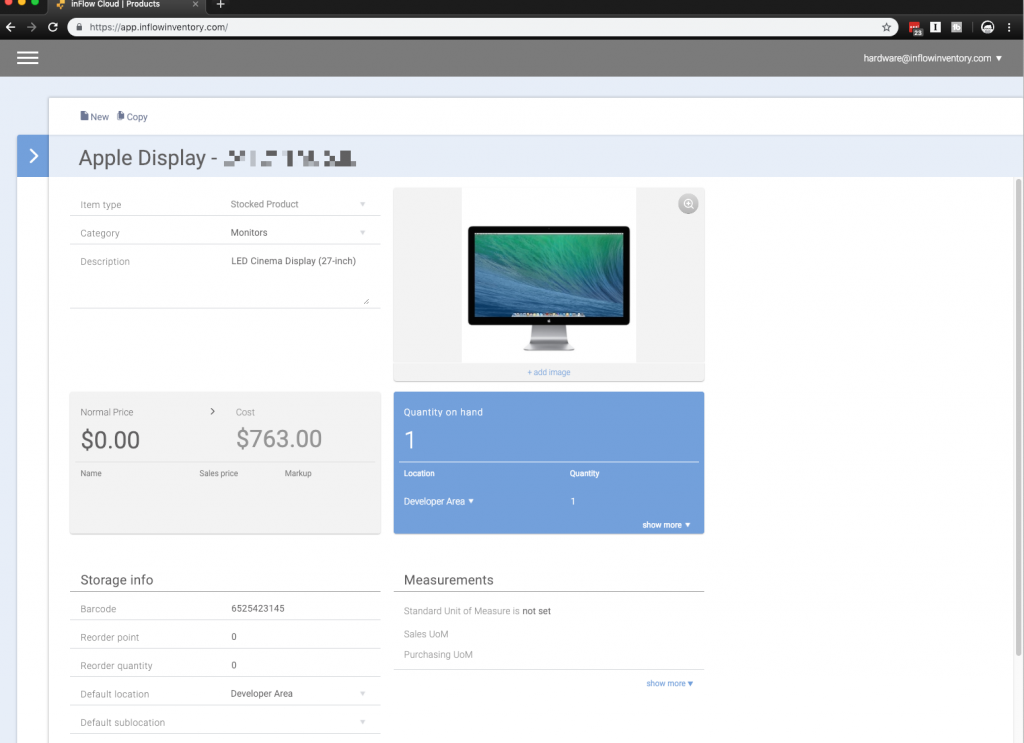Screenshot of the inFlow Cloud web app being used for asset tracking with an Apple Cinema display