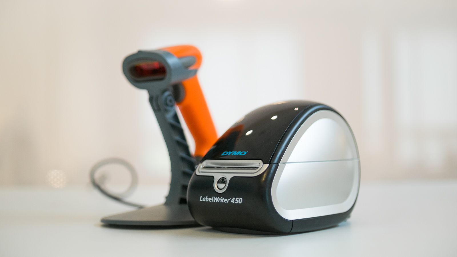A picture of a barcode scanner and label printer, essential hardware in a barcode system